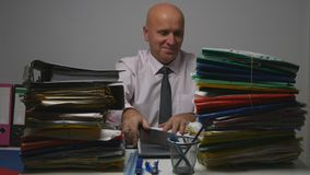 Happy Businessman Image Working In Financial Archive Room With Documents royalty free stock photo