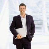 Happy businessman indoor Stock Images