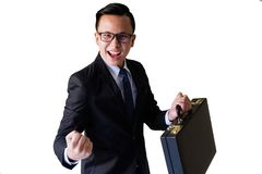 Happy businessman isolated on white. Portrait of happy young Asian businessman dressed in suit hold business bag isolated over white background, celebrating royalty free stock images