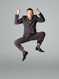 Happy businessman jumping. In air isolated on white background Stock Photo