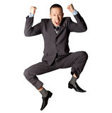 Happy businessman jumping. In air isolated on white background Royalty Free Stock Images