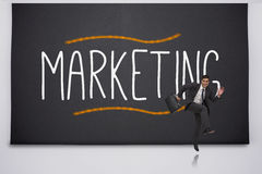 Happy businessman jumping against marketing Stock Image