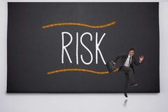 Happy businessman jumping against risk Royalty Free Stock Photos
