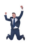 Happy businessman jumping in air Stock Photos