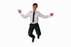 Happy businessman jumping in air isolated. Portrait of a happy businessman jumping in air against isolated white background Royalty Free Stock Photo