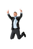 Happy businessman jumping. In the air with thumbs up Royalty Free Stock Image