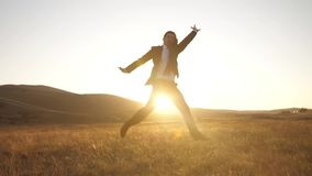 Happy businessman jumping stock footage