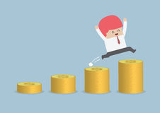 Happy businessman jumping on the money step Royalty Free Stock Images