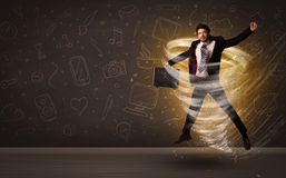 Happy businessman jumping in tornado concept. On brown background Stock Images