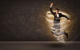 Happy businessman jumping in tornado concept. On brown background Royalty Free Stock Image