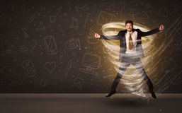 Happy businessman jumping in tornado concept. On brown background Stock Photography