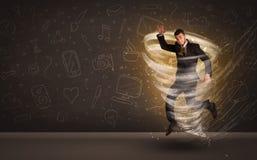 Happy businessman jumping in tornado concept Stock Photos