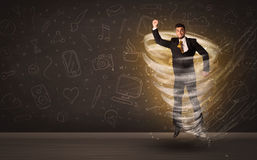 Happy businessman jumping in tornado concept Stock Photography