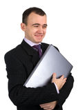 Happy businessman with laptop Stock Photography