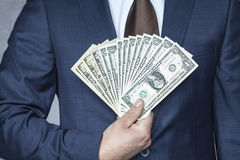 happy businessman with large cash Stock Image