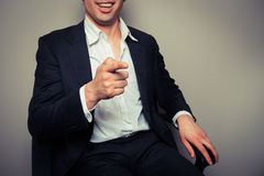 Happy businessman laughing and pointing Stock Photography