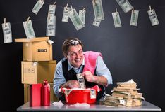 Happy businessman is laundering money Stock Photo