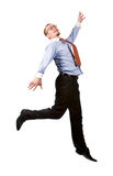 Happy businessman leaping into the air Royalty Free Stock Images
