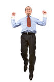 Happy businessman leaping into the air Stock Image