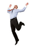 Happy businessman leaping into the air stock photo
