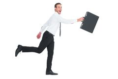 Happy businessman leaping with his briefcase Royalty Free Stock Photography