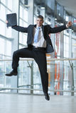 Happy Businessman leaps into the air Stock Photos