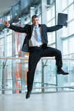 Happy Businessman leaps into the air Royalty Free Stock Photo
