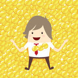 Happy businessman is lie down relaxing with gold coin penny stac Royalty Free Stock Images