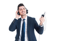 Happy businessman listen music in headphones and smile Stock Photography