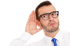 Happy businessman listening to something Stock Photography