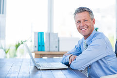 Happy businessman looking at camera with arms crossed. On white background Stock Photos