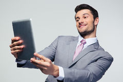Happy businessman looking at tablet computer Royalty Free Stock Photos