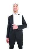 Happy businessman looking up holding laptop Stock Photo