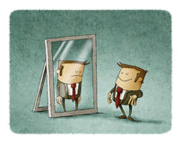 Happy businessman looks reflected sad. Happy businessman in front of a mirror where it looks reflected sad Stock Images