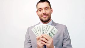Happy businessman with lot of dollar money stock footage