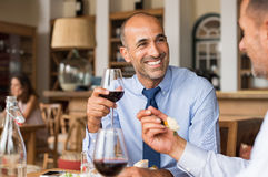 Happy businessman at lunch royalty free stock photo