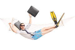 Happy businessman lying in a hammock Royalty Free Stock Photo