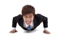 Happy businessman make push-ups stock photos