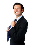 Happy businessman makes a quick adjustment Stock Image