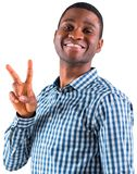 Happy businessman making peace sign Royalty Free Stock Images