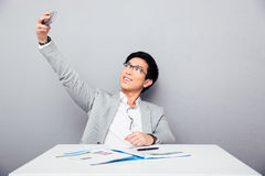 Happy businessman making selfie photo Stock Photo