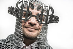 Happy, businessman with medieval executioner in metal and silver Stock Photo