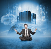Happy businessman meditating Stock Photography