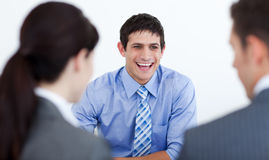 Happy businessman at a meeting Stock Photo