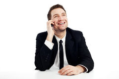 Happy businessman with mobile phone. Successful businessman talking by mobile phone smiling. Isolated on white Stock Photos