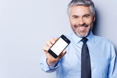 Happy businessman with mobile phone. Stock Photo