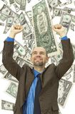 Happy businessman on the money background Stock Photos