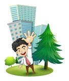 A happy businessman near the pine tree Stock Photography