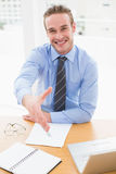 Happy businessman offering his hand Royalty Free Stock Images