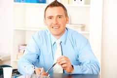 Happy businessman in office Stock Image